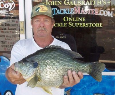 Robert Lawler of Lake Havasu City with what was a potential world-record, 5-pound, 7-ounce redear sunfish caught in 2011 from Havasu.